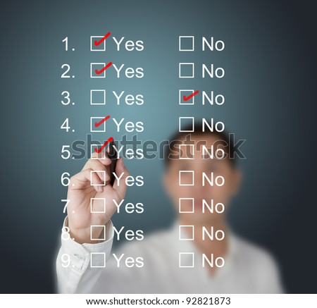 business man answering questions by make mark on yes or no boxes - stock photo