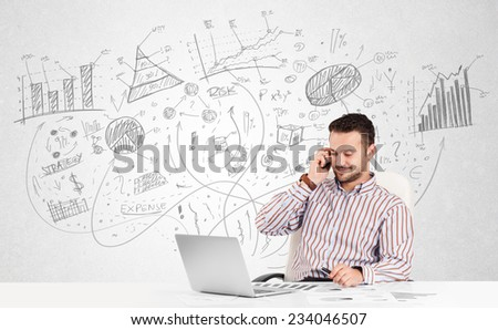 Business man at desk with hand drawn charts at the background - stock photo