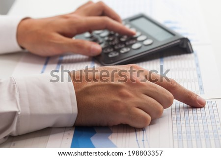 Business man at work in his office - stock photo