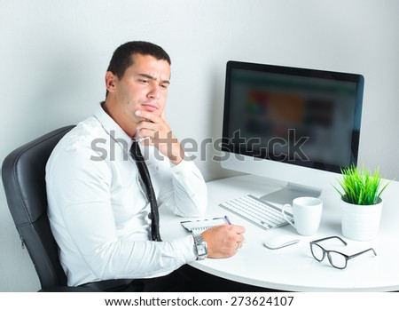 business man at work writing notes and planning - stock photo
