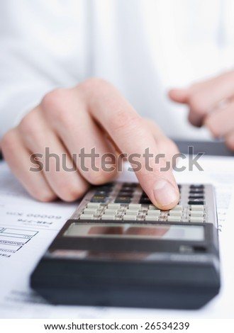 business man calculating - stock photo