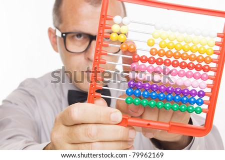 Business man calculating on abacus calculator, not isolated - stock photo