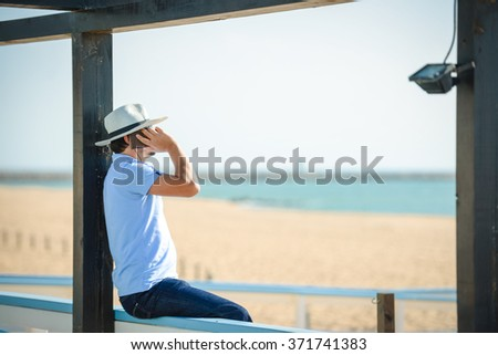 Business man calling by cell phone on the beach terrace background - stock photo