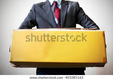Business man carrying an old box with hard work - empty box ready to fill in text - business work,debt, too much work and burden concept - stock photo