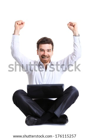 Business man celebrating his success with a computer laptop - stock photo