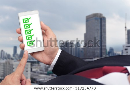 business man check list - stock photo