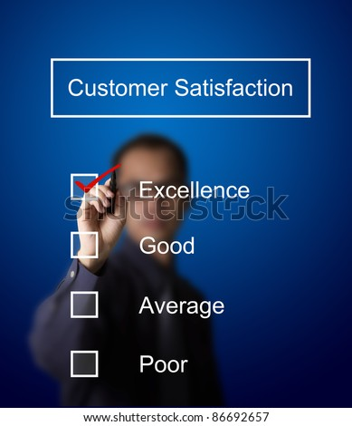business man checking  excellence on customer satisfaction survey form - stock photo
