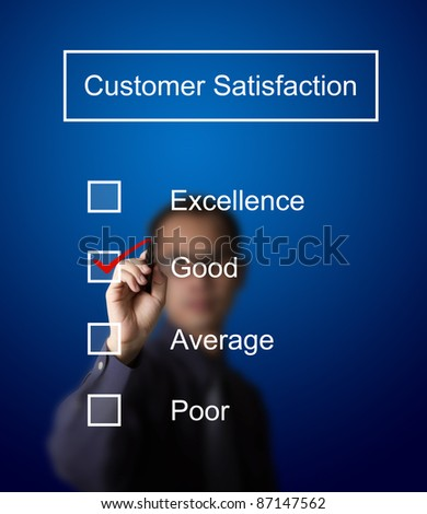business man checking  good on customer satisfaction survey form - stock photo