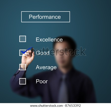 business man checking  good on performance evaluation form - stock photo