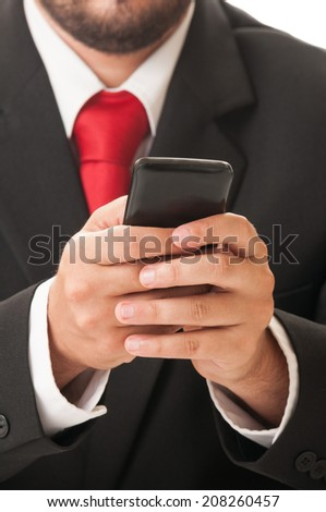 Business man checking the sales on his smartphone - stock photo