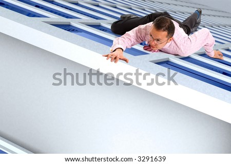 business man climbing a building almost reaching the top - stock photo