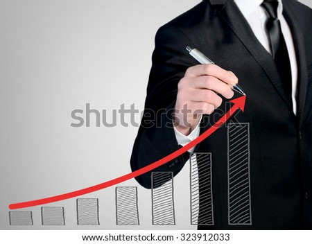 Business man close-up write success chart - stock photo