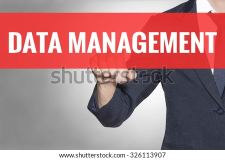 Business man Data Management word touching on red tab virtual screen for business concept - stock photo