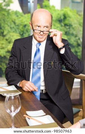 Business Man Discussing Development Growth Strategy With A Client During A Corporate Clientele Function At An Asian Restaurant, Grain Texture Added - stock photo