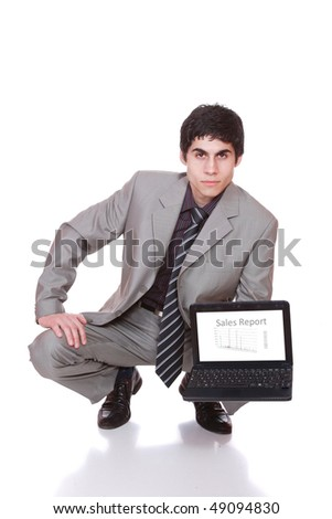 Business man displaying a laptop computer with sales report on the screen - isolated over a white background - stock photo