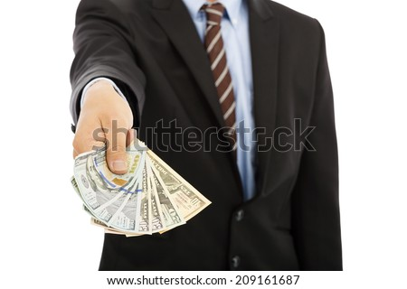 business man displaying a spread of us dollar cash - stock photo