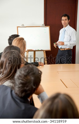 Business man doing a presentation at the conference room - stock photo