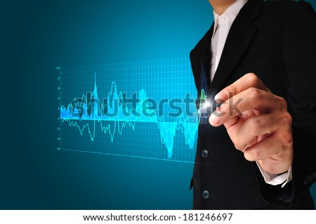 Business man draw analysis graph data for use as illustration. - stock photo