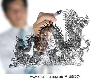 Business man draw chinese dragon - stock photo