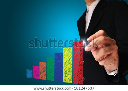 Business man draw graph with his hand on touch screen - stock photo