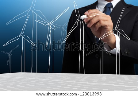 Business Man Draw Turbine Power Generator - stock photo