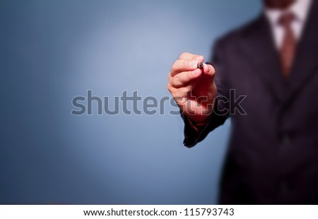 business man draw with marker on empty copy space isolated - stock photo