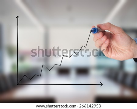 Business man drawing a growing graph. Isolated on office. Growth concept. Stock Image - stock photo