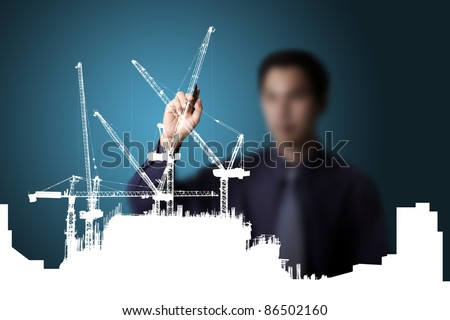business man drawing  construction site - stock photo