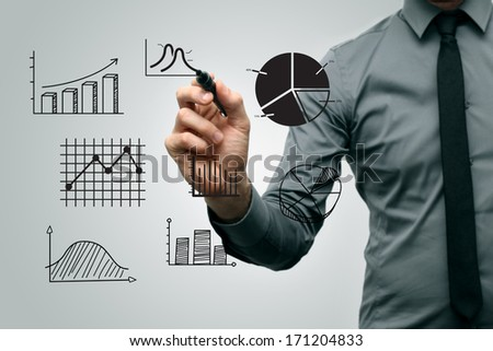 business man drawing different graphs and charts - stock photo