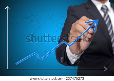 Business man drawing empty increase graph over blue background - stock photo