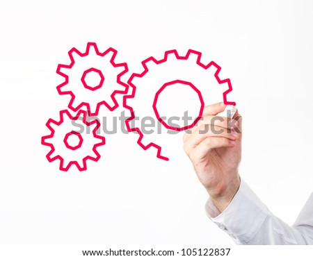 Business man drawing gears to screen. - stock photo