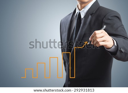 Business man drawing growth chart, success concept - stock photo