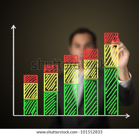 business man drawing growth stack bar chart - stock photo