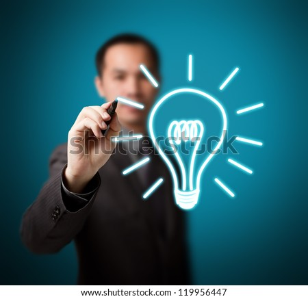 business man drawing idea light bulb - stock photo