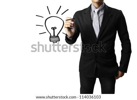 Business man drawing light bulb - stock photo