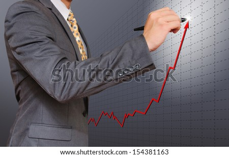 business man drawing uptrend chart - stock photo