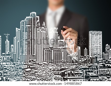 business man drawing urban city building development - stock photo