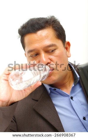 business man drinking a water - stock photo