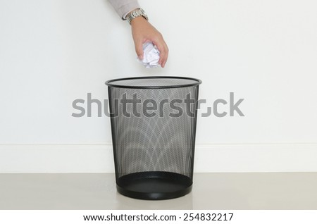 Business man drop wastepaper in to recycle bin - stock photo