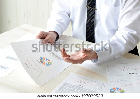 Business man explaining in meeting - stock photo