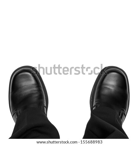 Business man feet isolated on white - stock photo