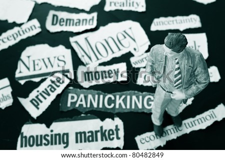 Business man figure standing on bad news headlines - stock photo
