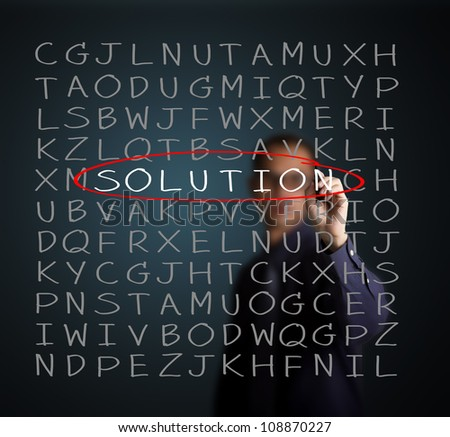 business man find solution on random alphabet puzzle - stock photo