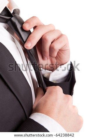 Business man fixing his tie, isolated over white - stock photo