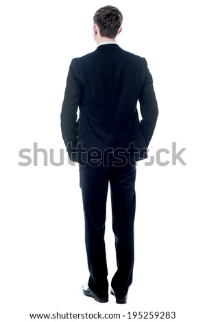 Business man from the back, looking at something - stock photo
