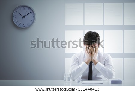 Business man frustrated and ashamed with hands on face - stock photo