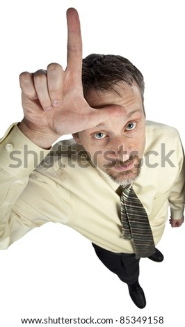 business man gesturing loser on his forehead - stock photo