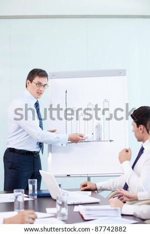 Business man gives a presentation at the office - stock photo