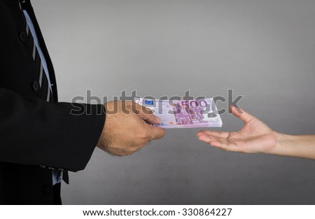 business man  gives money to human - stock photo