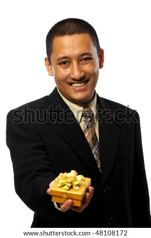 Business man giving a gift isolated on white background - stock photo